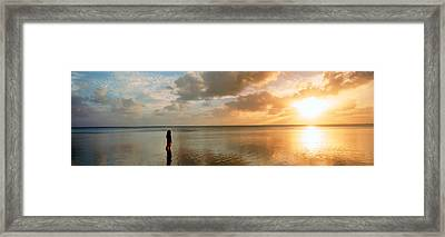 Woman Standing On Sandbar Looking Framed Print by Panoramic Images