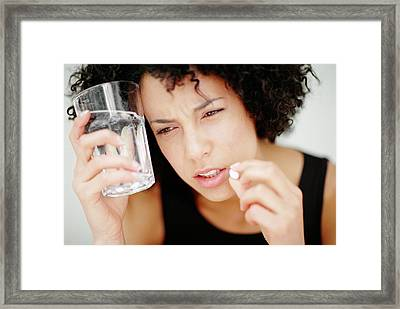 Woman Taking A Pill Framed Print by Ian Hooton/science Photo Library