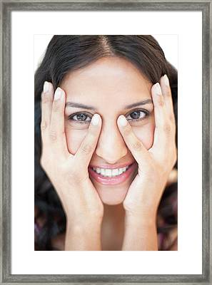 Woman Touching Face Framed Print by Ian Hooton