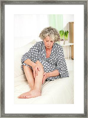 Woman Touching Her Legs Framed Print by Lea Paterson