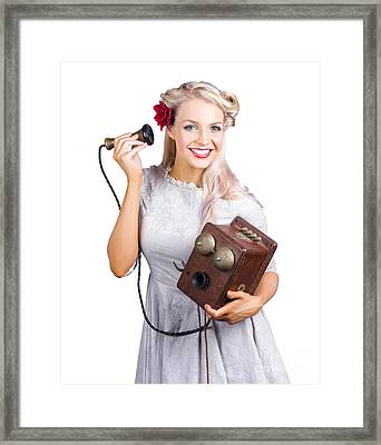 Woman Using Antique Telephone Framed Print