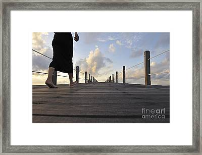 Woman Walking On Wooden Jetty At Sunrise Framed Print by Sami Sarkis