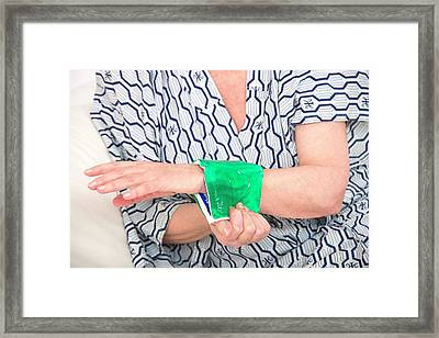 Woman With A Cold Compress On Wrist Framed Print by Lea Paterson