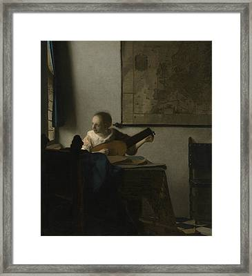 Woman With A Lute Framed Print by Johannes Vermeer
