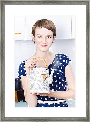 Woman With Asian Tea Pot Framed Print