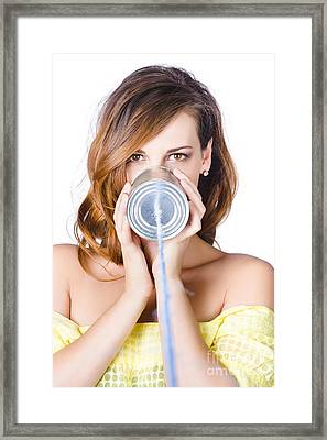 Woman With Can And Wire Phone Framed Print