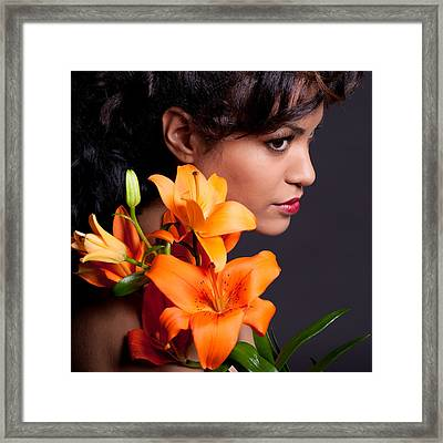 Woman With Lily Flowers Framed Print