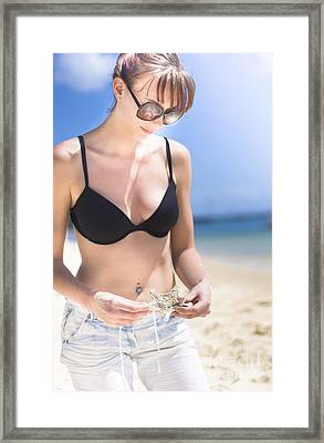 Woman With Starfish On Beach Framed Print