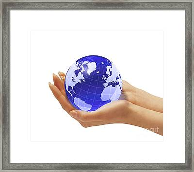 Womans Hands Holding An Earth Globe Framed Print by Leonello Calvetti