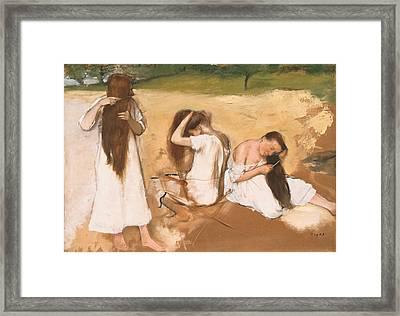 Women Combing Their Hair Framed Print by Edgar Degas