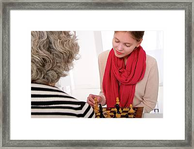 Women Playing Chess Framed Print by Lea Paterson