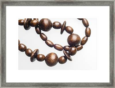 Wooden Beads Necklace Framed Print by Alain De Maximy