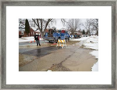 Worker Repairing Water Mains Framed Print by Jim West