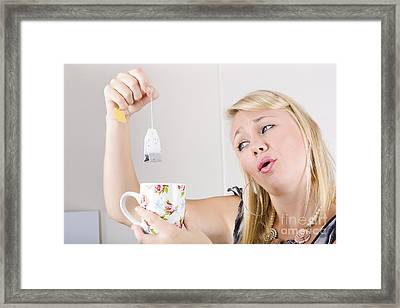 Worker With Look Of Relief Holding Tea Bag And Cup Framed Print by Jorgo Photography - Wall Art Gallery