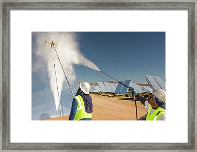 Workers Washing The Heliostats Framed Print by Ashley Cooper