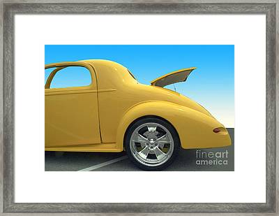 Yellow Coupe Framed Print