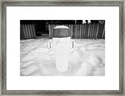 yellow fire hydrant in the snow by the side of the road Saskatoon Saskatchewan Canada Framed Print