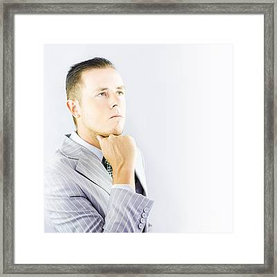 Young Businessman Looking Thoughtful Framed Print by Jorgo Photography - Wall Art Gallery
