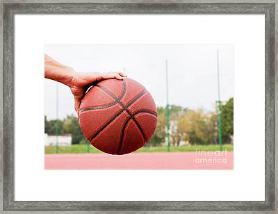 Young Man On Basketball Court. Framed Print by Michal Bednarek