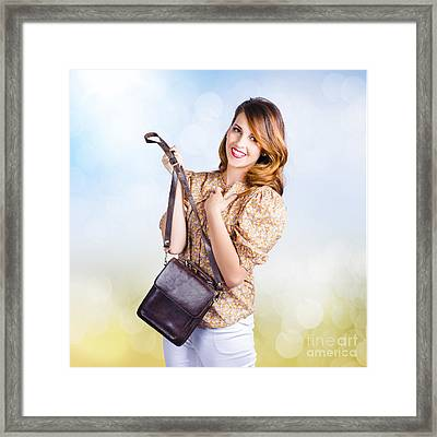 Young Retro Fashion Model Holding Leather Handbag Framed Print by Jorgo Photography - Wall Art Gallery