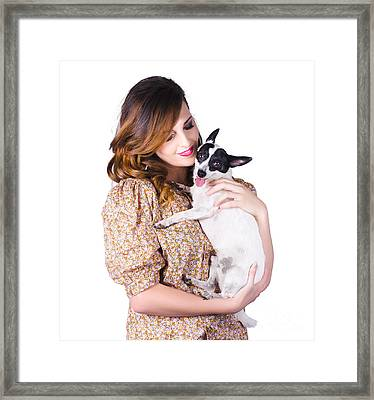 Young Woman Holding Dog Framed Print by Jorgo Photography - Wall Art Gallery
