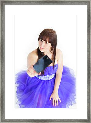 Young Woman Using Smartphone Framed Print