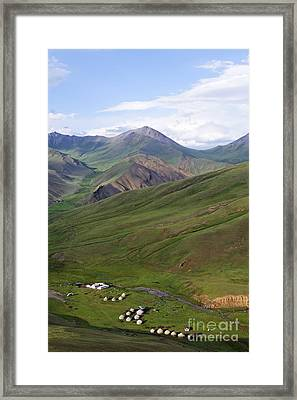 Yurts In The Tash Rabat Valley Of Kyrgyzstan  Framed Print