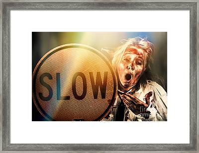 Zombie Business Person Holding Slow Sign  Framed Print by Jorgo Photography - Wall Art Gallery