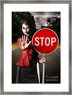 Zombie Girl Holding Stop Sign At Dead End Framed Print by Jorgo Photography - Wall Art Gallery