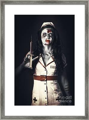 Zombie Nurse Holding Bloody Euthanasia Syringe Framed Print by Jorgo Photography - Wall Art Gallery