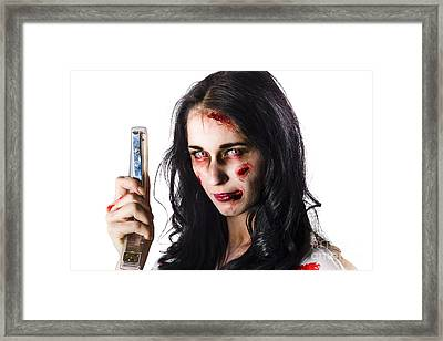 Zombie Woman With Stapler Framed Print by Jorgo Photography - Wall Art Gallery
