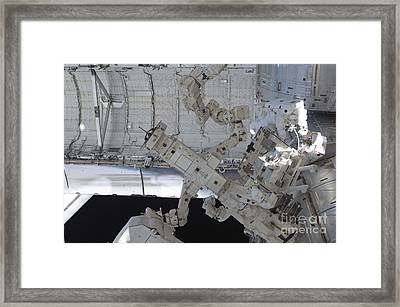 Astronauts Working On The International Framed Print