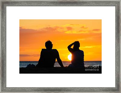 Couple Watching The Sunset On A Beach In Maui Hawaii Usa Framed Print