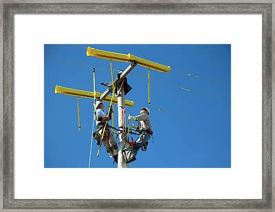 Repairing Power Lines Framed Print by Jim West