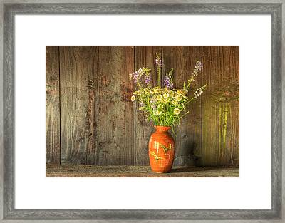 Retro Style Still Life Of Dried Flowers In Vase Against Worn Woo Framed Print by Matthew Gibson