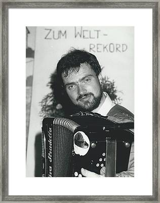 103 Hours Playing On His Accordion Framed Print by Retro Images Archive