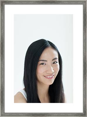 Woman Smiling Framed Print by Ian Hooton