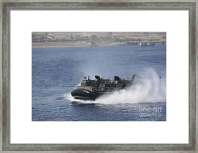 A Landing Craft Air Cushion Transits Framed Print by Stocktrek Images