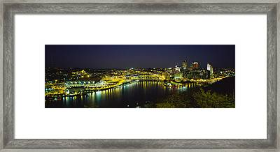 High Angle View Of Buildings Lit Framed Print