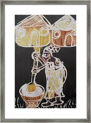 Village Scene.woman Pound The Yam Tuber  Framed Print