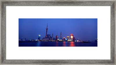 Buildings At The Waterfront Lit Framed Print