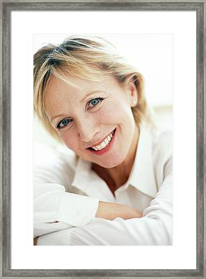 Smiling Woman Framed Print by Ian Hooton/science Photo Library