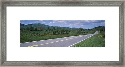 Road Passing Through A Landscape Framed Print