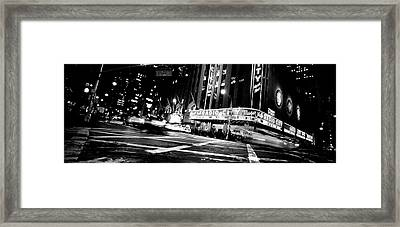 Low Angle View Of Buildings Lit Framed Print by Panoramic Images