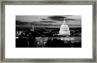 High Angle View Of A City Lit Framed Print