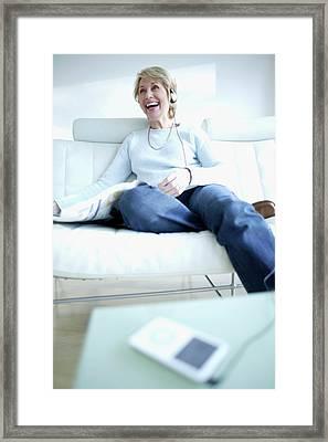 Woman Listening To Music Framed Print by Ian Hooton/science Photo Library