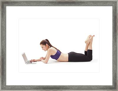 Woman Using Laptop Framed Print by Ian Hooton