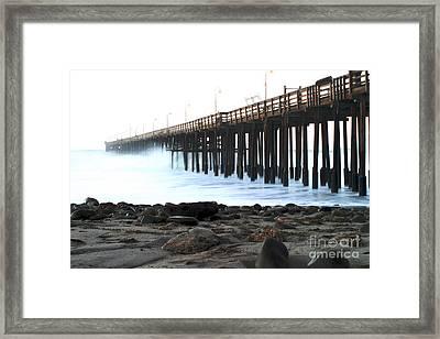 Ocean Wave Storm Pier Framed Print by Henrik Lehnerer