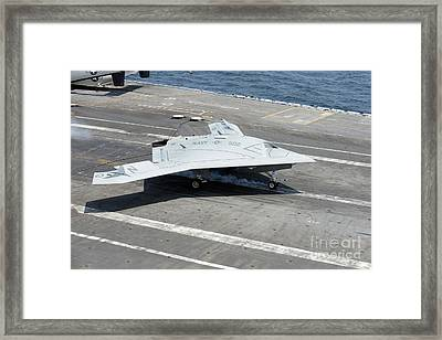 An X-47b Unmanned Combat Air System Framed Print