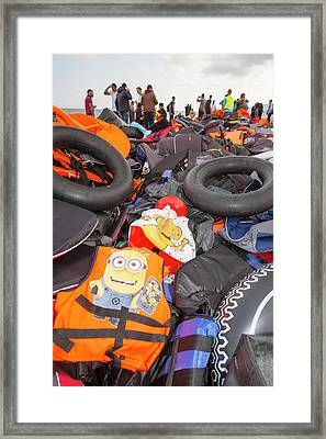 Syrian Refugees Arriving On Greek Island Framed Print by Ashley Cooper
